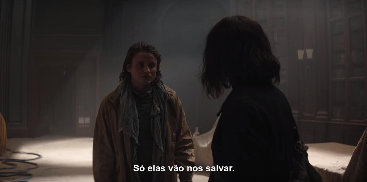 Captura de tela do sétimo episódio da terceira temporada, com Bartosz (2) dizendo a Martha (2), na sede do Erit Lux: 'Só elas vão nos salvar'.