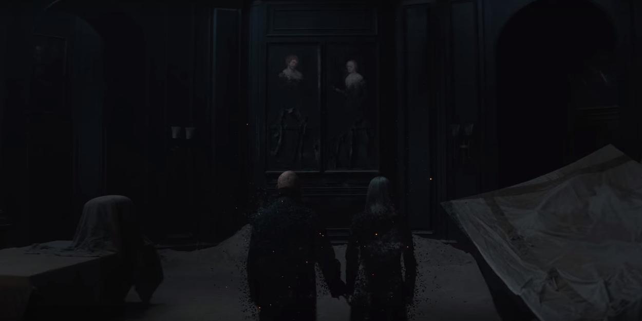 Cena de T03E08 em que Adão e Eva vão se desfazendo, de mãos dadas, quando os universos são destruídos.